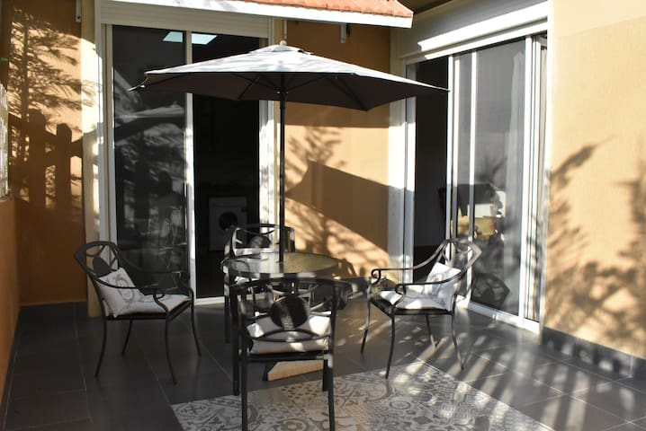 Exclusive & spacious 3-bed apartment with Patio