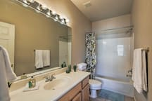 The second bath features a spacious vanity and a shower/tub combo.