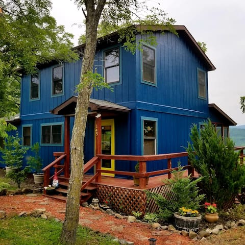 "New exterior ""nocturne blue"" paint job Summer 2018.  Hopefully captures the happiness of the home"