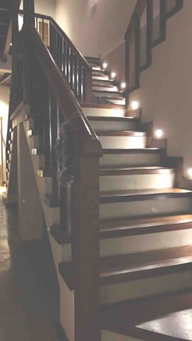 Wide stairway to the first floor where all the bedrooms are.