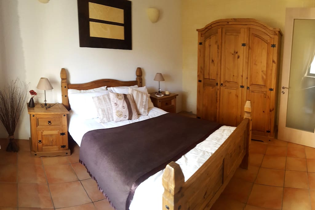 Warm and inviting double bedroom with full length mirror and double wardrobe