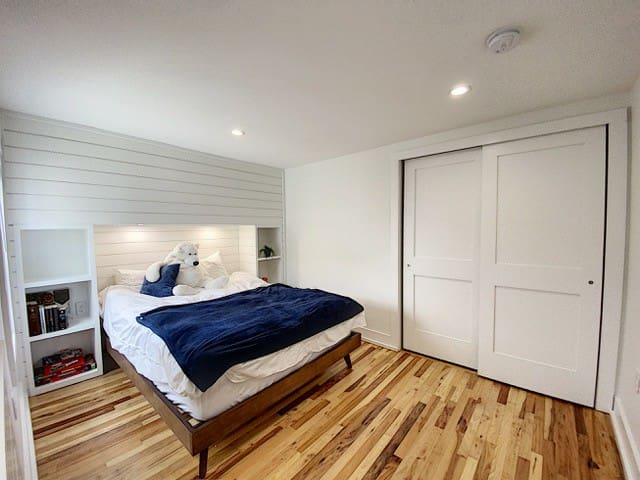 Queen bedroom with  direct access to 2nd floor deck - maybe with a cup of morning joe? Also here brand new top of the line Beauty Rest mattress