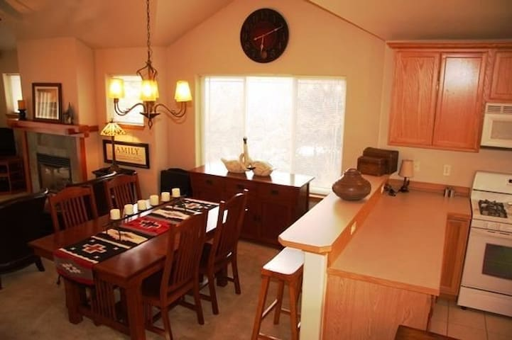 Kitchen opens to dining area w chandelier for ambience & entertaining.  Enjoy casual meals, conversation & activities seated at the kitchen pass-through.