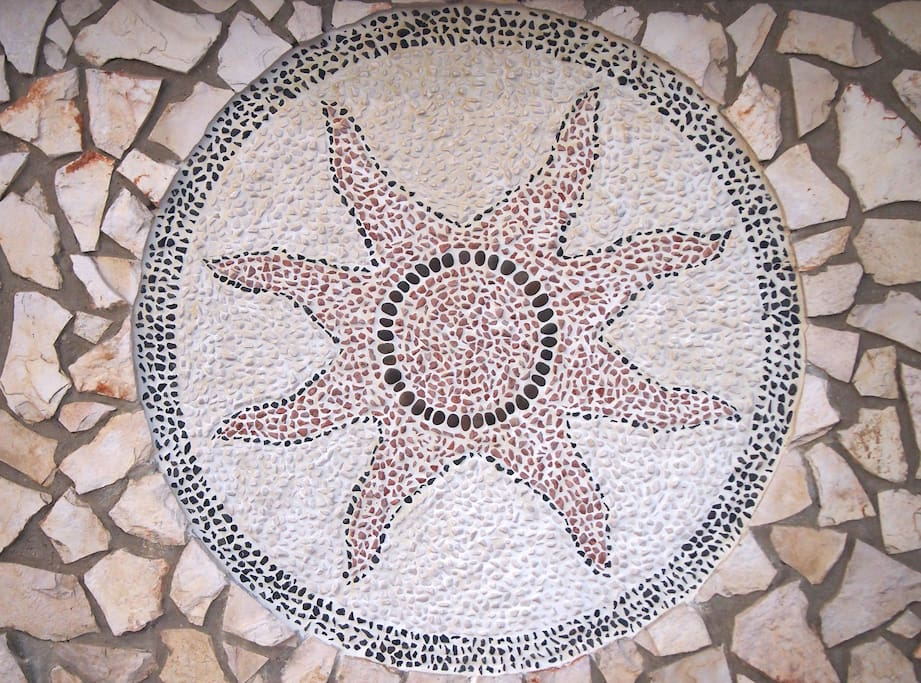 A splendid mosaic of stones at the entrance