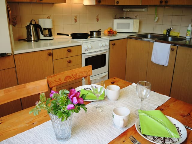 The kitchen is located in the apartment and it is shared by all our guests.