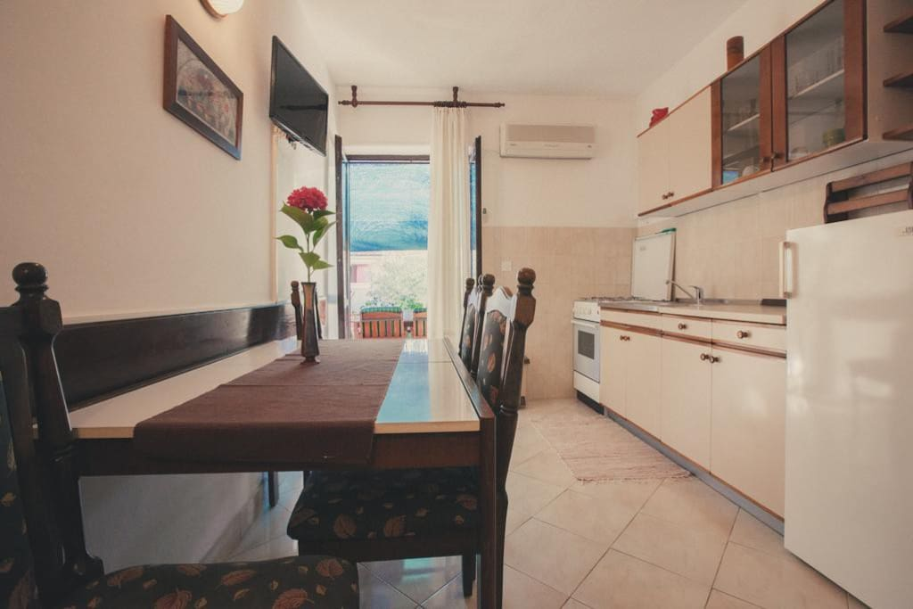 kitchen and living room .. you can see entrance to the terrace ..