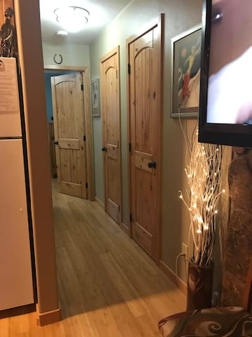 Beautiful wood flooring, doors, and cabinetry throughout.
