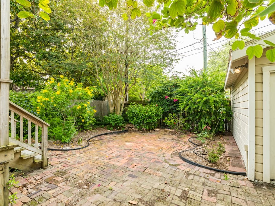 The brick covered rear yard offers plenty of room for fun while you cook out or enjoy the night breeze.