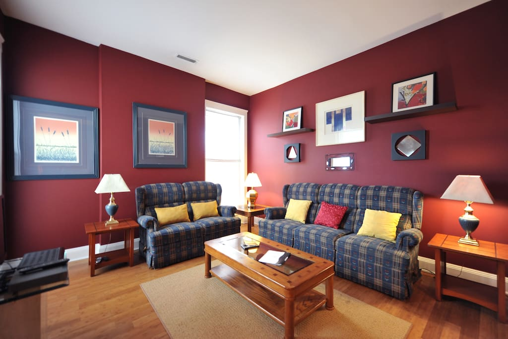 Living room with reclining sofa and loveseat.