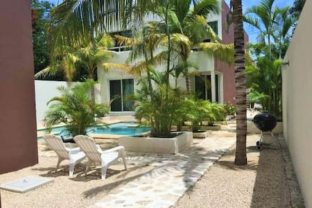 We are located on the south end of Tulum in an area called Lavaleta, It is secure , quiet, and only a 5 minute walk to the famous El Camello Restaurant and a short drive to the beach or about a 25 minute bike ride.We has lots of exotic birds.