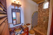 The third washroom employs the familiar tile and antique elements throughout the villa.