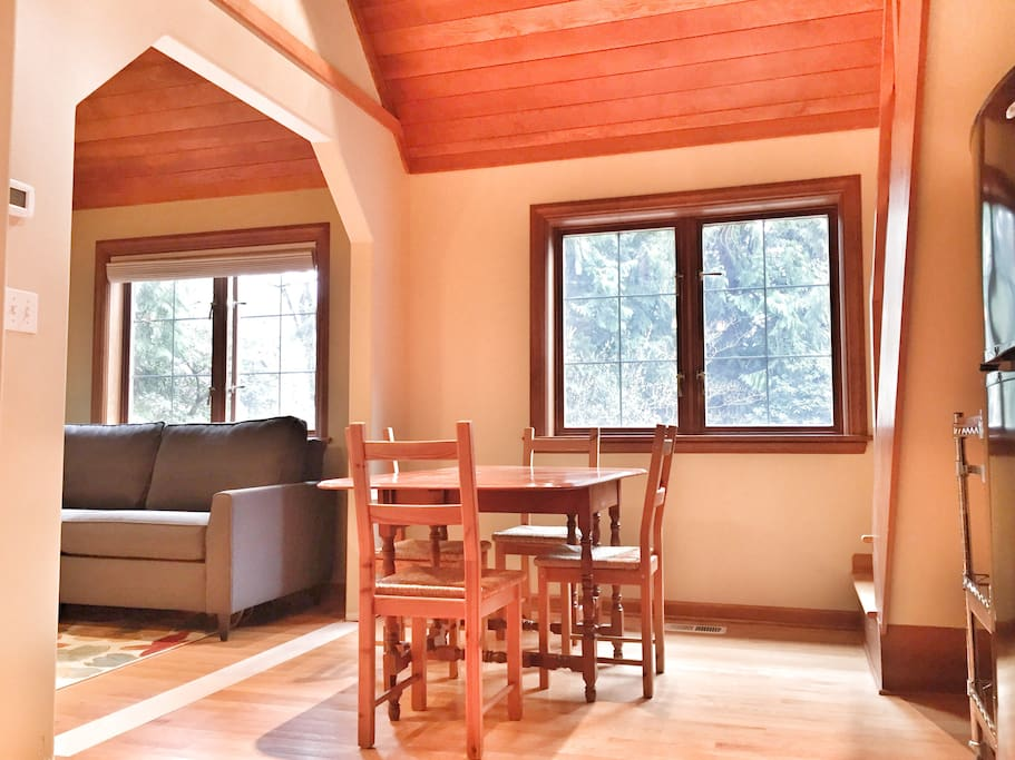 Open living room, dining room, kitchen with cathedral ceilings