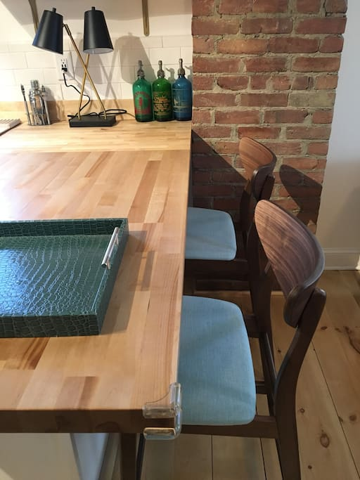 Butcherblock countertop/workspace with mid-century style stools