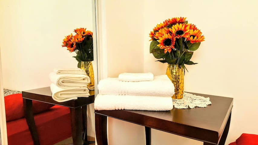 Fresh towels are provided. There is a full-sized mirror in your bedroom.