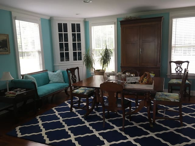 Dining room/sitting room. This space can be modified to accommodate a third adult, an infant or up to 2 children. Complimentary Pack and Play and cots for children available by request. Queen size size Frontgate bed also available for an additional $20.