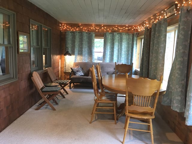 Three-season porch; this space is not heated, but there is a space heater. The futon can be used as an extra bed.