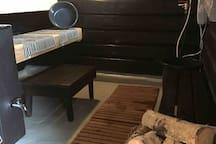 The sauna, sauna stove warming with wood and shower with warm water!