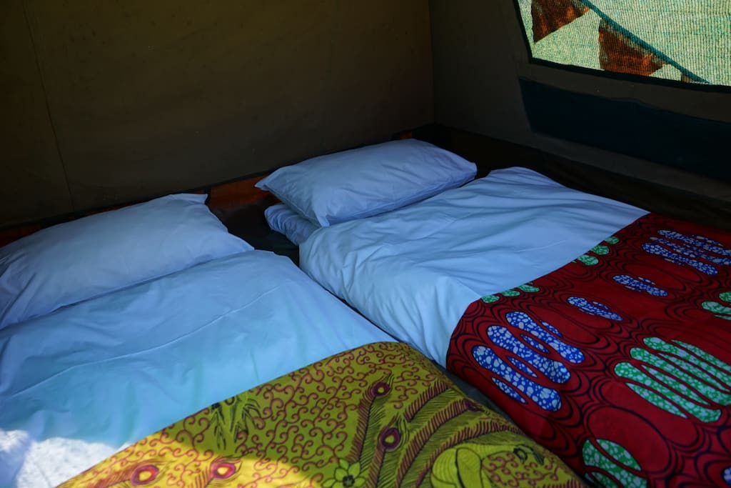 2 people can sleep in each tent, or one person