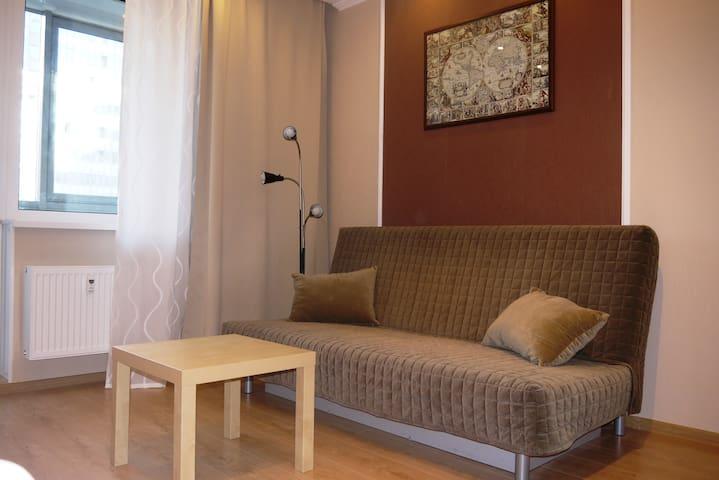 Уютная студия возле метро Девяткино - Murino - Apartment