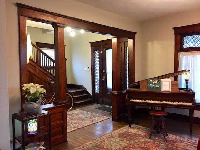 This is the front room. And that's an old baby grand piano a neighbor gave me. It's not in great shape, but is playable. I offer a $10 rebate to any guest who will play at least three songs on it for me. Play another instrument? Let me know.