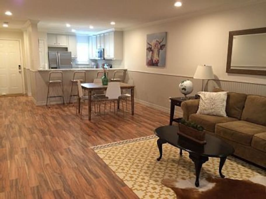 Open living space with direct access to carport and pool from townhouse entrances.