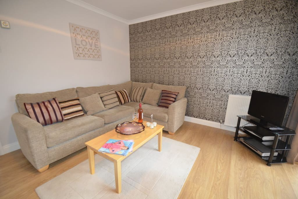 A stylish and comfortable Living Room with access to the outdoor space