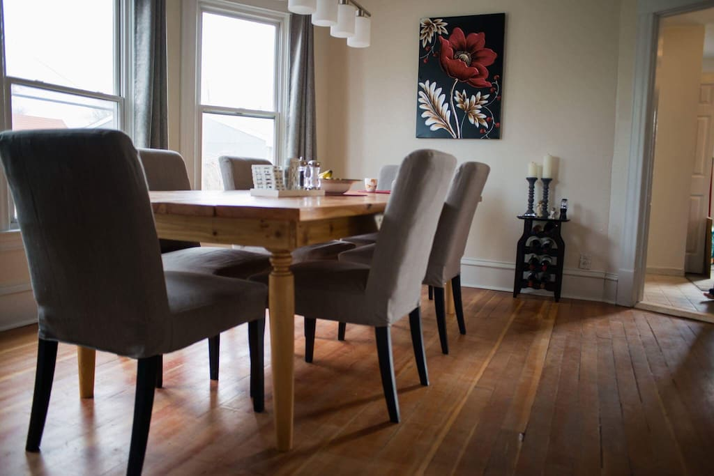 Dining room with a handmade table by Priscilla's dad from red cedar. Fits 8-10 people. Join us for breakfast or dinner if we are around!