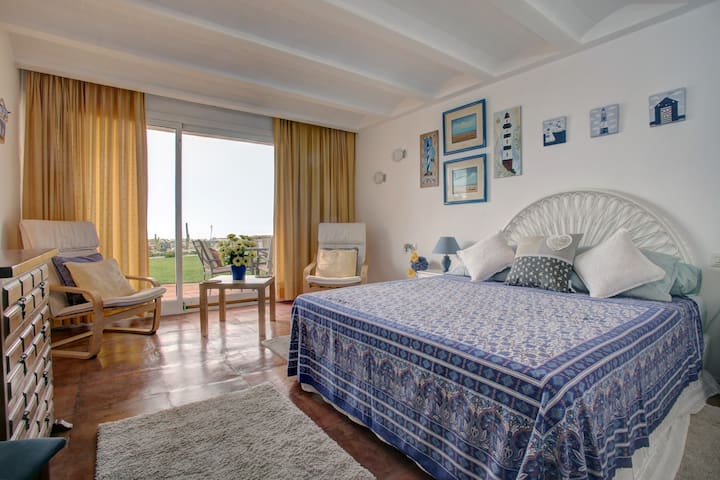 Bedroom ground floor with ensuite bathroom and direct access to front sea garden and beach