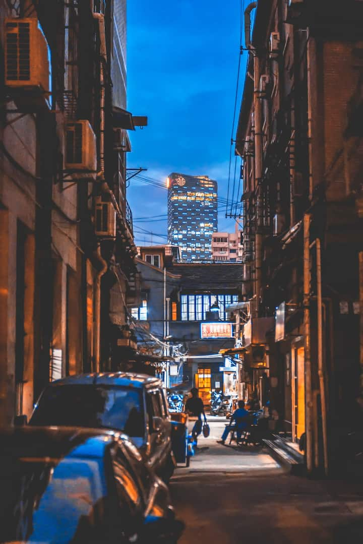 Old alleyway behind the high skyscraper