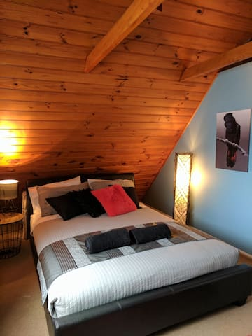 The Black Cockatoo Room is a generous-sized bedroom upstairs in the cottage and is airconditioned.