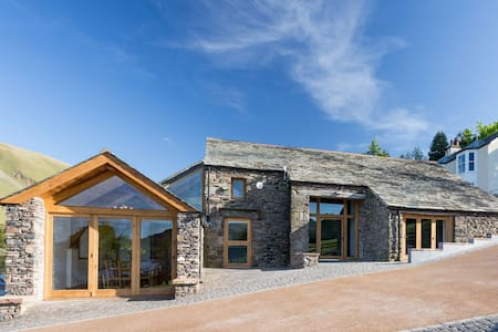 Luxury lakeside barn set in 26 acres with four en suite bedrooms