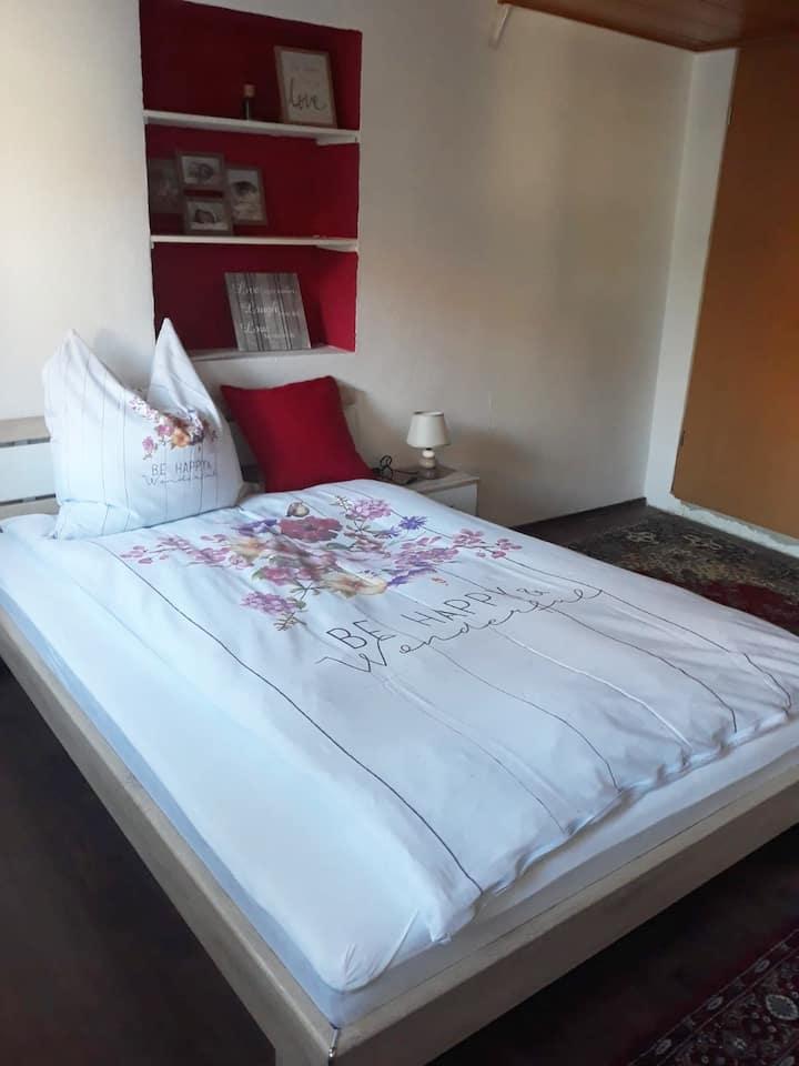 Chic bedroom near Porsche