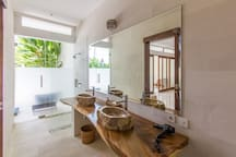 The downstairs bathroom opens out to the pool area.