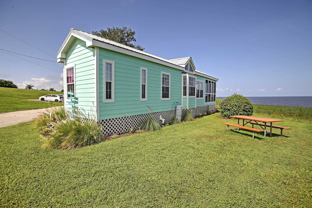 Nested alongside Lake Okeechobee, this cottage boasts unobstructed views and easy access to the water.