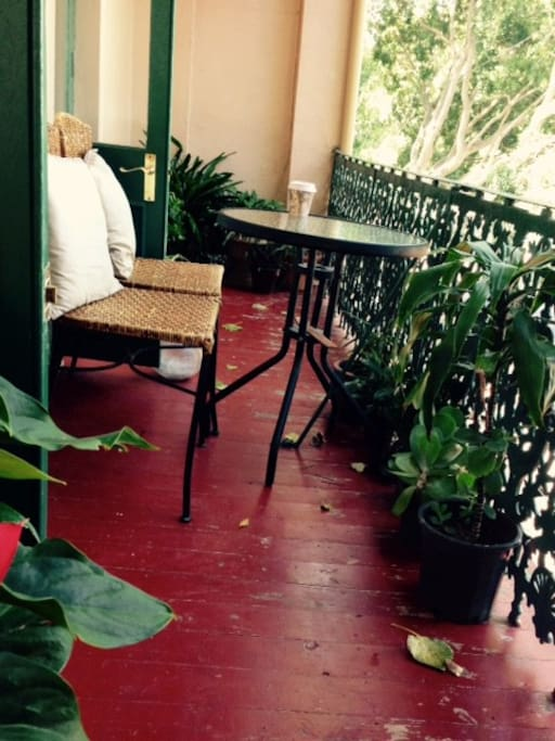 Leafy private balcony with breakfast table for two
