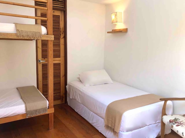 """Four impeccable beds with wooden floor and ceiling. Private bathroom for each room. Airy and very functional. """"Tortuga"""" room # 3"""