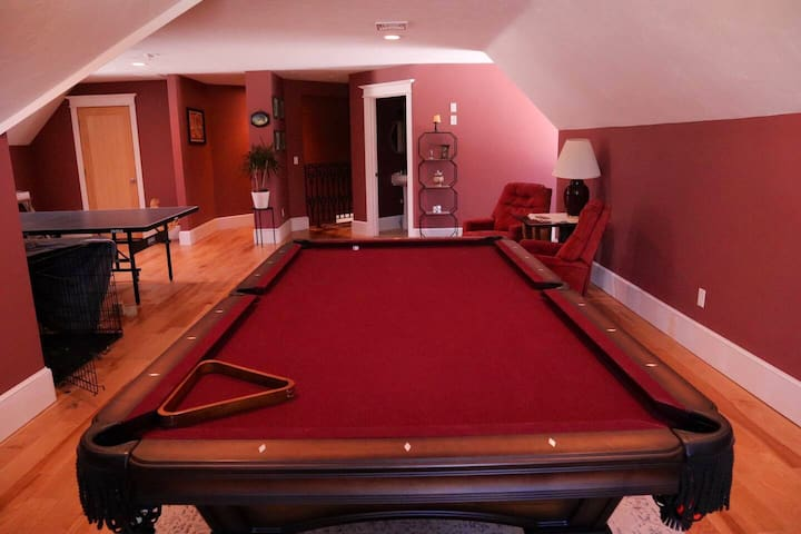 Upstairs recreation area with full billiards table, and ping pong table.