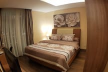 """Bedroom with Comfy bed, LED TV 32"""" and Computer"""