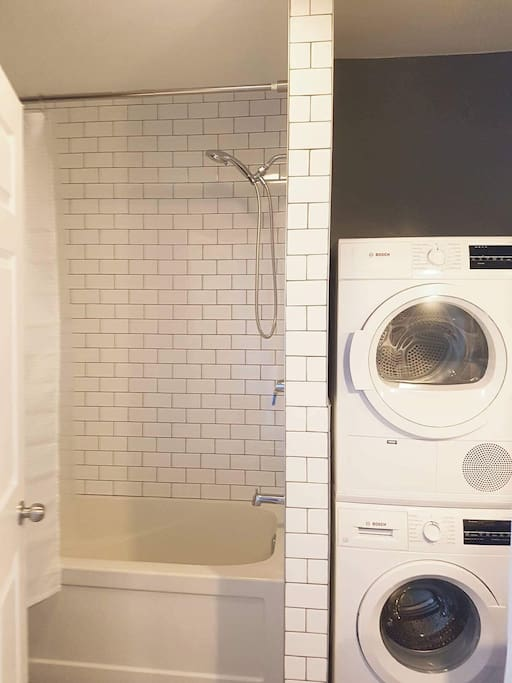 Renovated washroom with washer and dryer