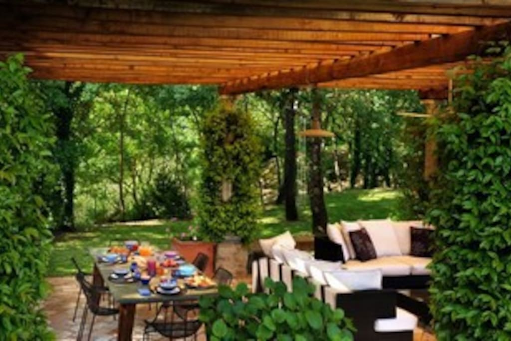 Common eating and sitting area in the lush garden