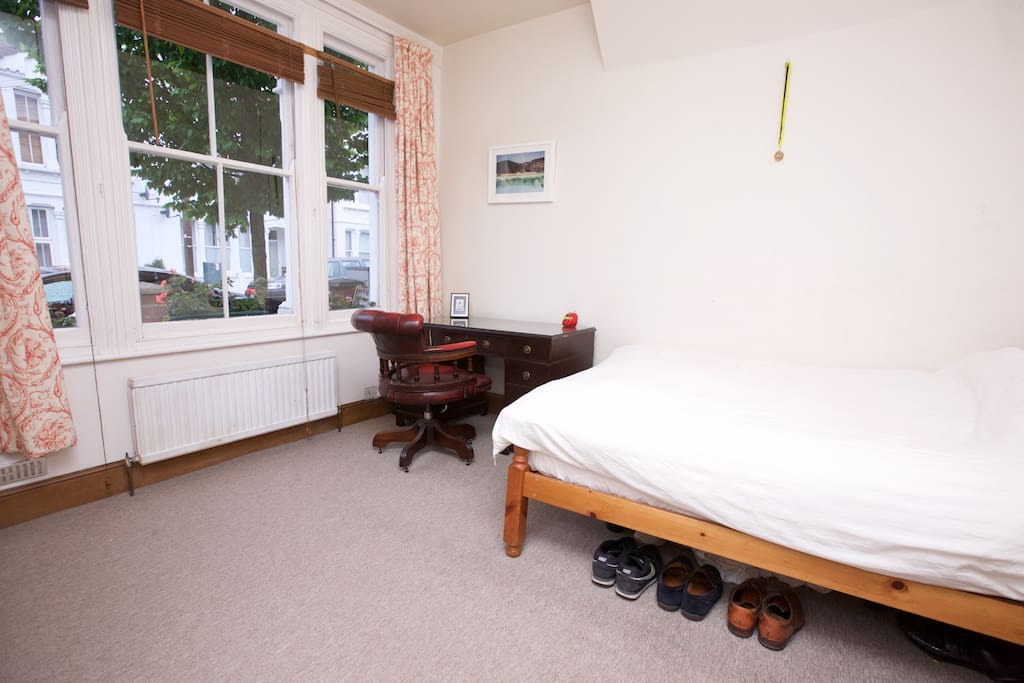 Master bedroom - queen size bed and desk and chair. Plenty of hanging space in fitted cupboards