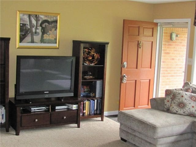 Cozy living room with large, comfortable sectional sofa and flat screen TV with cable service.