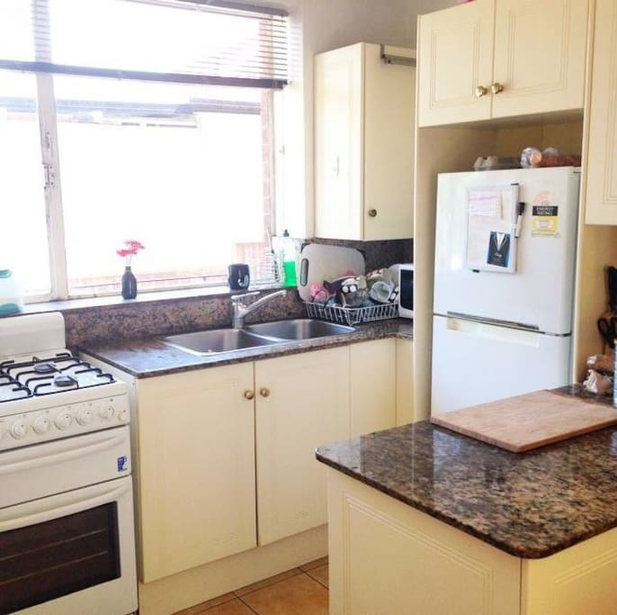 Fully Equipped Kitchen inc Fridge Freezer, Oven and Microwave.