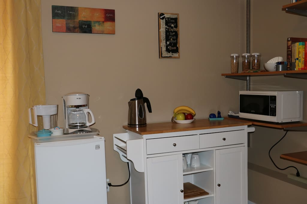 Kitchenette area, fully stocked.