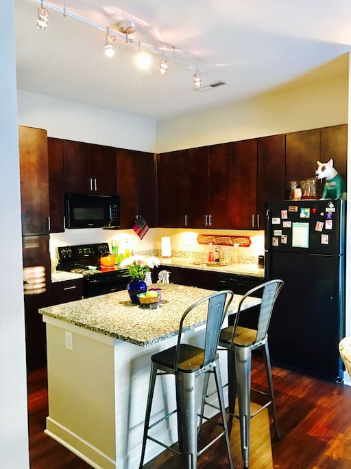 Eat in kitchen with granite countertops.