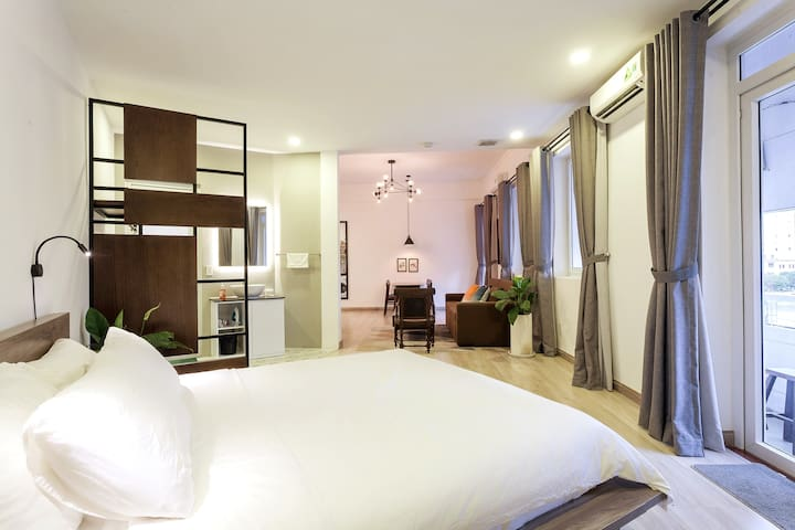 Our expansive studio has distinct sleeping, living/dining and kitchen areas. Perfect for business travelers or couples