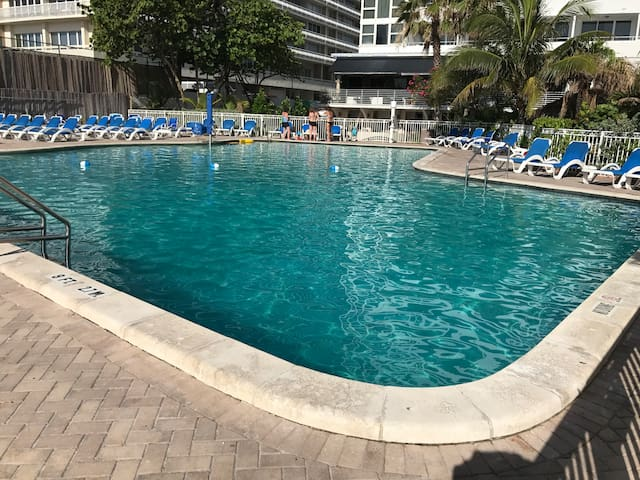 Very large heated pool with plenty of all complimentary lounges