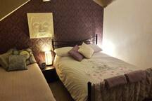 Your cosy bedroom on 2nd floor with double & 1 or 2 single beds (typical layout)
