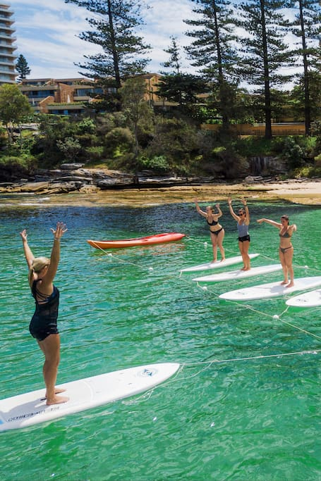 SUP Yoga in Paradise with a local Yogini