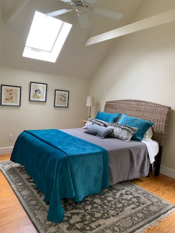 Queen Size Bed with Sky View Windows ceiling fan open concept